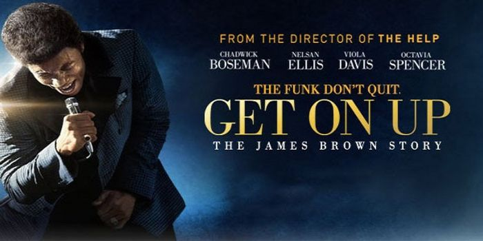 Chadwick Boseman impersonating James Brown sings into a microphone on a movie poster for the film Get On Up.